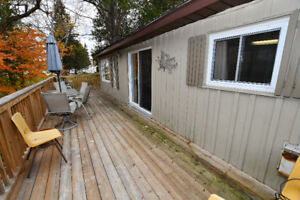GOOD SIZED BUNGALOW ON COUNTRY LOT! 6590 HWY 35, Coboconk