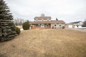 IMMACULATE TWO STOREY HOME WITH 2 GARAGES!
