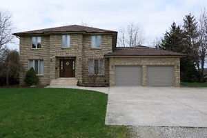 BEAUTIFUL CUSTOM BUILT TWO STOREY HOME ON 1 ACRE LOT