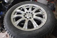 215 55 16 general altimax arctic winter tires  on fast rims