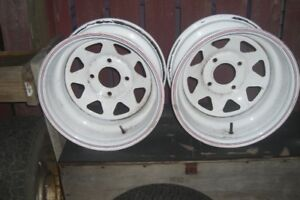TWO 15 INCH TRAILER RIMS WITH 4 HOLE MOUNTS