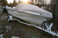 17.5 FT GREW BOAT WITH 140HP EVINRUDE MOTOR AND WISCOT TRAILER