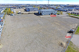 Industrial shop with office space and fenced storage lot