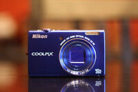 Blue Nikon Coolpix Point and Shoot Camera