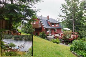 2361 Kews Rd- Charming Lakefront Home w/ Cottage & Suite + Dock!