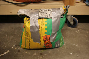Bag of thinset Mortar, white and grey