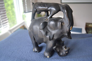 HAND MADE EBONY CARVING An elephant fighting against two lioness