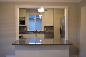 **BEAUTIFULLY RENOVATED** 4 BEDROOM UNIT - AVAILABLE IMMEDIATELY