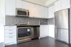 1 Bed + Den + Parking [Available August 1]