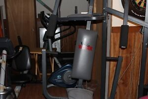 Treadmill, home gym, exercise bikes, weight bench and weights