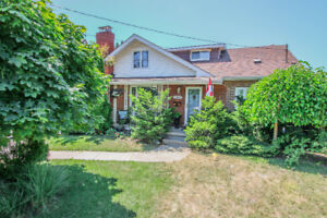 Lovely 1.5 Storey 4 Bedroom Home in Convenient Central Location!