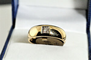 BRAND NEW SOLID STAMPED 14 K. BAND WITH 1 DIAMOND FOR SALE