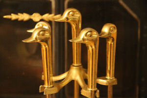 FIREPLACE TOOL - GOLD DUCK? GEESE?