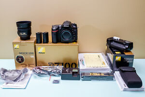 Nikon Camera D7100 w/ battery pack, 35mm f/1.8 lens, 2 batteries