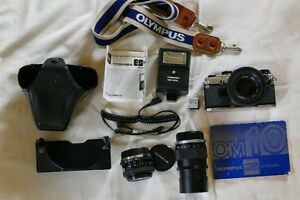 OLYMPUS om10 CAMERA WITH SEVERAL LENSES