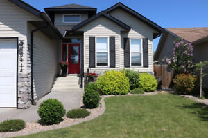Custom Built Walk-Out with Two Double Garages! 1 With Large Loft