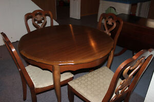 Oak dining table and 4 matching chairs