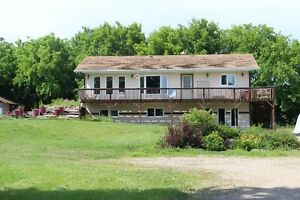 Live the Peaceful Acreage life by the lakes! Livelong