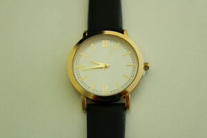 Black strap, white and gold face watch