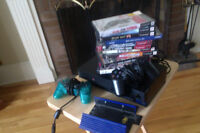 Playstation 2 w/ 2 controllers, 2 memory cards, 12 games