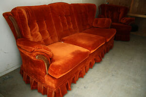 Vintage couch and chair set in red/orange velvet.