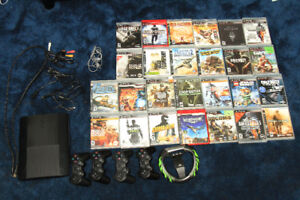 PS3 Super Slim with 27 games and accessories