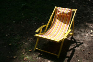 Beach chair, Yellow in color. Cozy and Relaxing chair for sale.