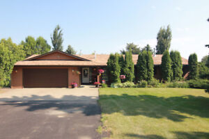 Bungalow Nestled onto 1.05 Acres in Sturgeon County!
