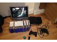"""Sony PlayStation2 with 25 original including Venturer 15"""" LCD TVs with the mounting bracket."""
