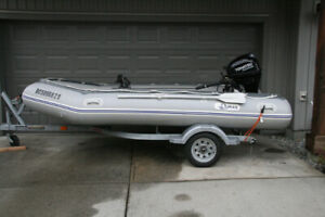 12.5' inflatable boat with 20hp motor and trailer