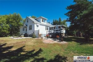 Remodeled 1 3/4 Storey character Home in Beautiful Setting