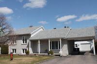 Belle grande maison à paliers multiples - Arvida