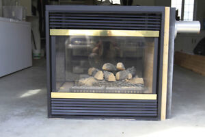 Invermere: Peninsula 3-sided fireplace, propane-burning for sale