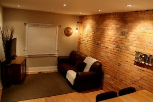 TRENDY LOFT-STYLE BRICK ROWHOUSE IN OTTAWA ST. N. AREA