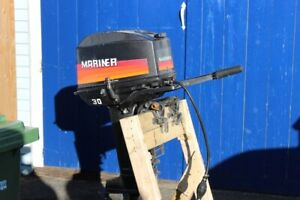 1989 30 horsepower Mariner outboard with tank