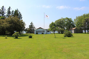 WATERFRONT COTTAGE WITH BARN FOR SALE ON A DOUBLE LOT