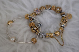 Authentic Pandora twotone bracelet with 14k gold/silver charms
