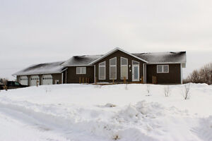 Pristine Acreage with Size, Garage, and Livestock Facilities!