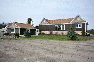 2 houses on 5 acres with Shop and huge garage.. make us an offer