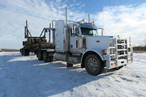 2006 Peterbilt and 2006 Kenworth logging trucks