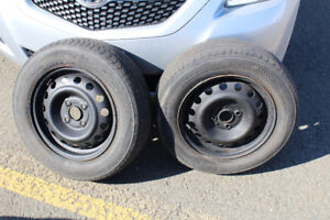Two 2008 Hyundai Accent rims 14 inch with all season tires for s