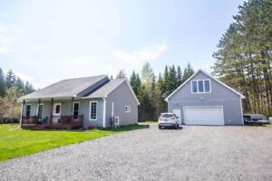 CUTE HOME PLUS AWESOME DETACHED GARAGE WITH MAN CAVE!