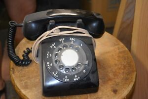 Black rotary phone. Working condition