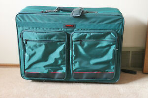 Clean Suitcase with Wheels   $15