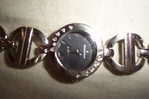 Woman,s watch, Christian Picard, asking $20.00