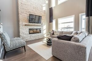 SOUTHWEST SHOWHOME FOR SALE! UPGRADED WITH HIGH CEILINGS!