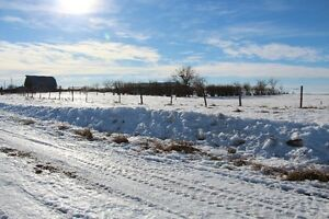10 acres featuring large heated shop, storage shop, barn/corrals