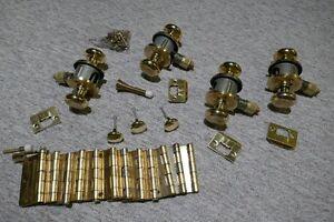 Gold Door knobs, hinges, door stops and miscellaneous