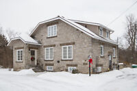 Century Stone Home on River for Sale