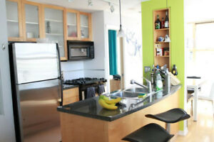 Bright corner suite, fully furnished 1 bedroom/den w parking